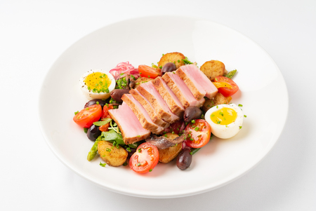Salade niçoise on the white plate