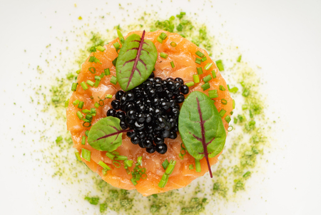 salmon tartare on the white plate