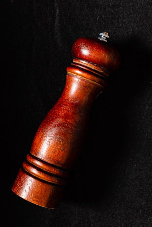 pepper mill on the black background