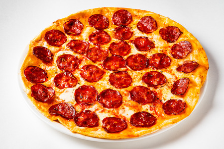 Hot Homemade Pepperoni Pizza on the white background