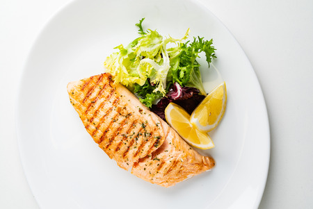 Grilled Salmon with Fresh Salad Leaves and Lemon