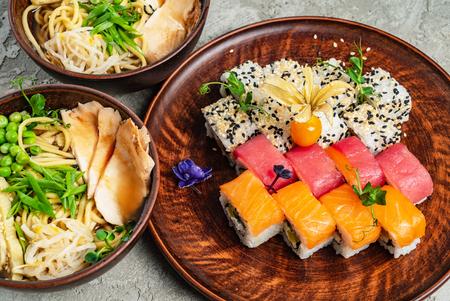 Rainbow Sushi Roll with salmon, eel, tuna, avocado, royal prawn, cream cheese Philadelphia, caviar tobica, chuka. Sushi menu. Japanese food 스톡 콘텐츠 - 121849583