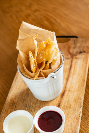 baked brushwood dessert with sauces Stock Photo