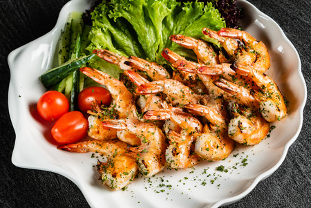 grilled shrimps with salad and wine