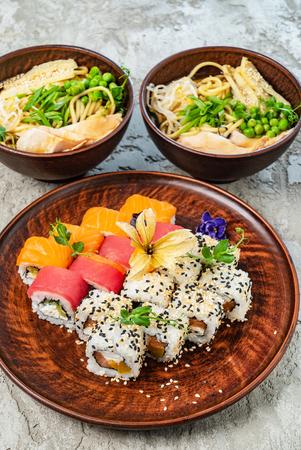 Rainbow Sushi Roll with salmon, eel, tuna, avocado, royal prawn, cream cheese Philadelphia, caviar tobica, chuka. Sushi menu. Japanese food 스톡 콘텐츠 - 121849343