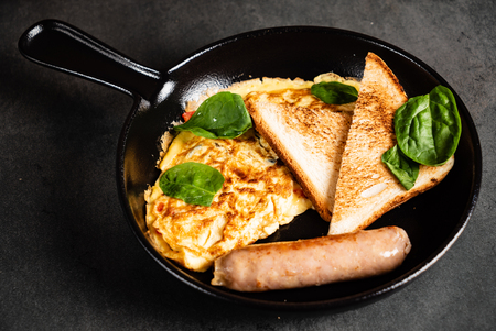 omelet with toasts and sausage Banco de Imagens