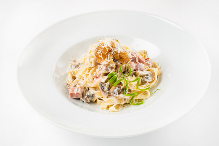 Carbonara pasta, spaghetti with pancetta, egg, hard parmesan cheese and cream sauce. Stock Photo