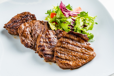 grilled meat : beef ( lamb ) garnished with salad