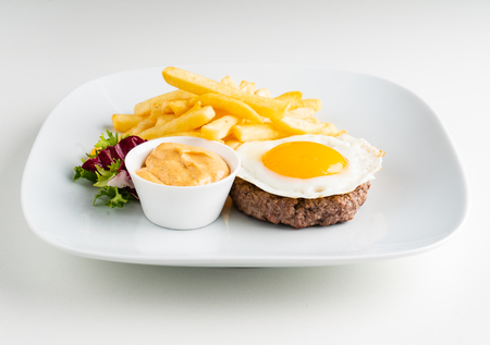 cutlet with egg and french fries Standard-Bild - 121400056