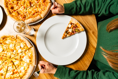 woman eating pizza in the cafe Stock Photo
