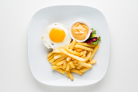 cutlet with egg and french fries Standard-Bild - 121400172