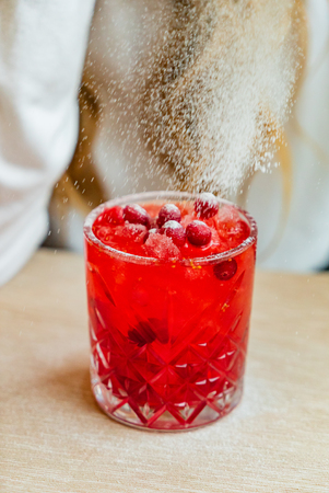 woman drinking cranberry mocktail