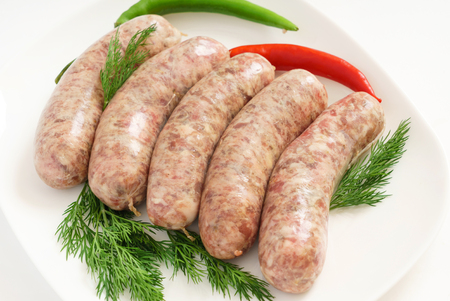 raw sausages with herbs