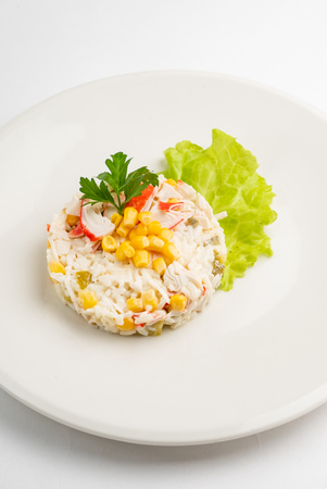 salad made of crab sticks, corn, egg, pepper, and cucumber 写真素材