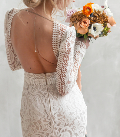 nice young bride with flowers Stock Photo