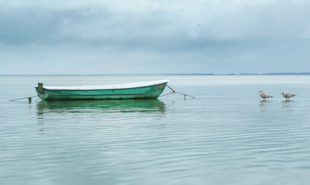 Empty Boat in the Sea Water