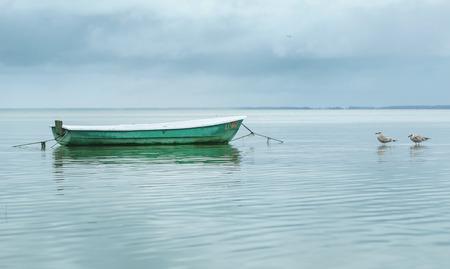 Empty Boat in the Sea Water Archivio Fotografico - 123765628