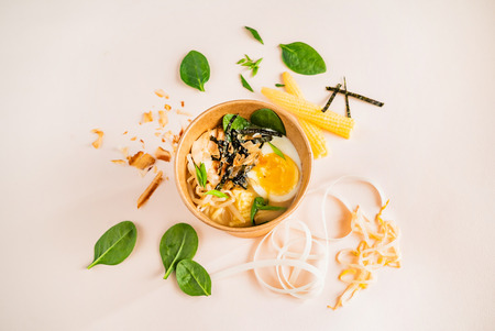 rice noodle with egg and spinach in the box