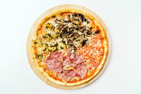 tasty pizza on the white, top view