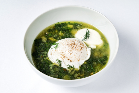spring soup with nettle and egg Stock Photo