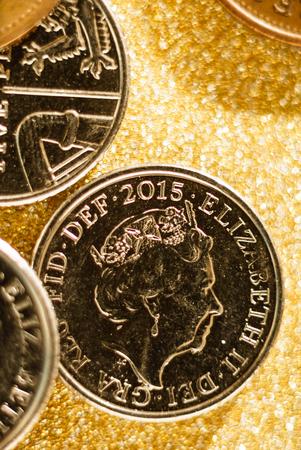 British coins on  golden backgrounds, British coins.