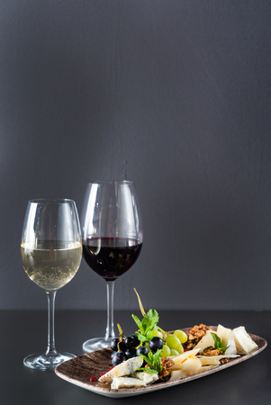 plate cheese and flute of wine Stock Photo
