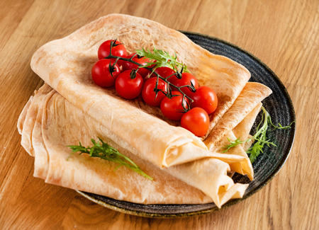 pita bread with spice and cherry tomatoes