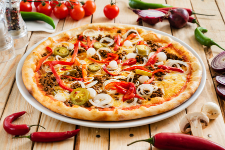 tasty pizza on the wooden background 版權商用圖片 - 123768273