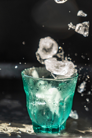 ice cubes flying in the glass