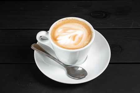 cup of cappuccino on the black background 版權商用圖片
