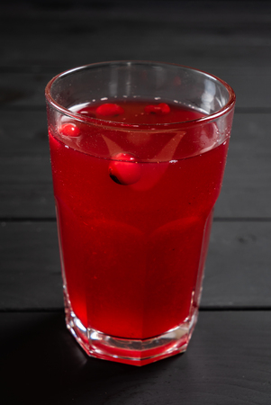 cranberry lemonade on the black wooden background