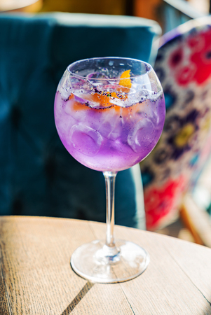 Lavender cocktail with orange zest 스톡 콘텐츠
