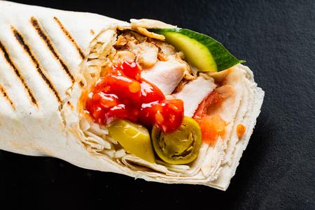 Fajita wrap sandwich on the black