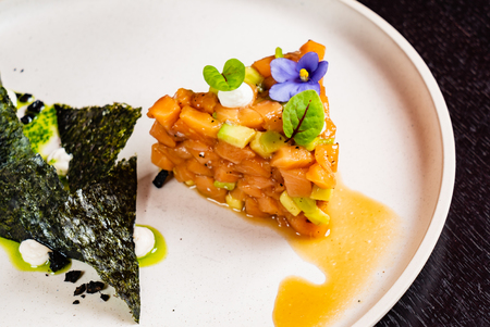 Salmon tartare with avocado and seaweed