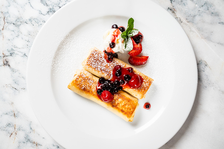 pancakes with strawberries and mint Stock Photo