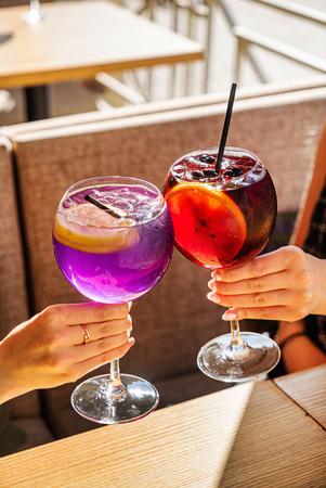 women drinking summer fresh cocktail