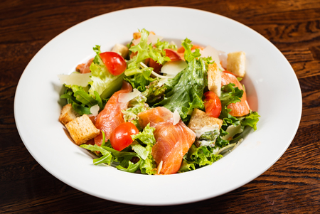 caesar salad with salmon fish