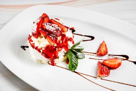 Dessert with strawberries and ice cream