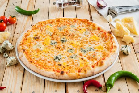 cheese pizza on the wooden background Stock Photo - 125078711