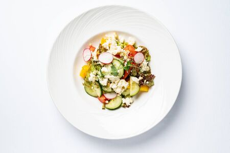 Vegetable salad on the white plate