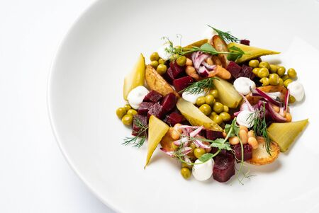 Vegetable salad with beetroot on the white plate