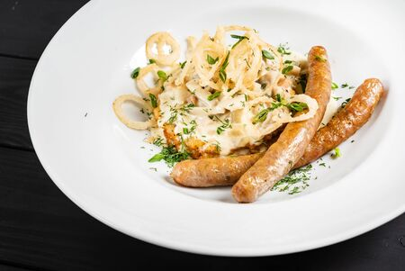 Potato pancakes with sausages and fried onion