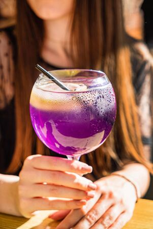 Women drinking summer fresh cocktail 스톡 콘텐츠