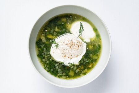 spring soup with nettle and egg 写真素材