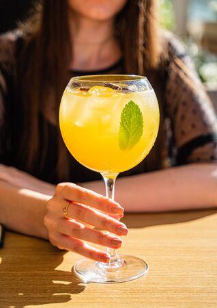 woman drinking summer fresh lemonade