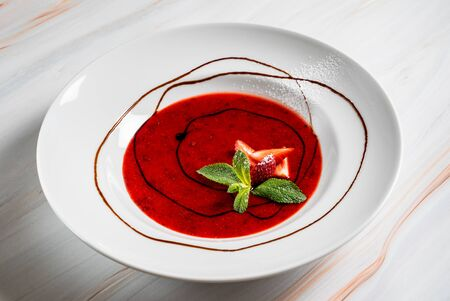 strawberry soup with chocolate sauce