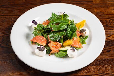 Caesar salad with salmon fish Фото со стока