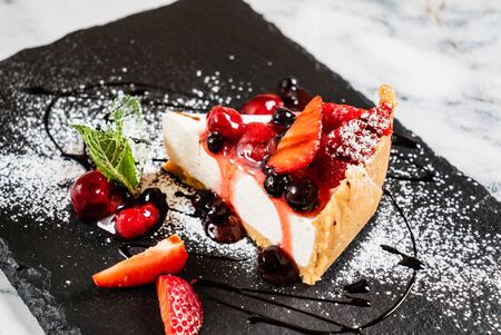 Cheesecake with fresh strawberries and mint Reklamní fotografie