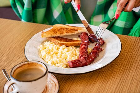 Woman eating breakfast in the cafe Stock Photo