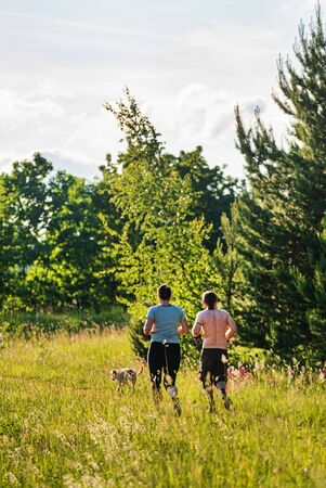 Couple with Dog  Exercising Together Outdoors